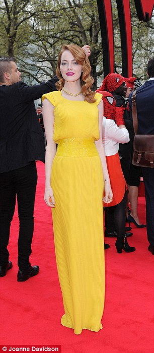 Emma Watson in marigold-yellow Atelier Versace dress with matching Swarovski crystal beading on the shoulders and waist